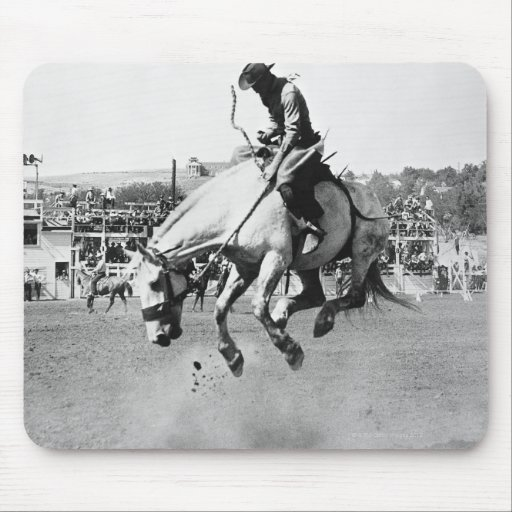 Man riding bucking horse in rodeo mouse pad