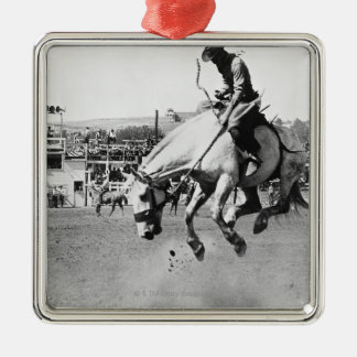 Man riding bucking horse in rodeo Silver-Colored square decoration