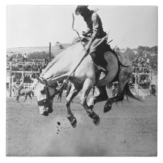 Man riding bucking horse in rodeo tile