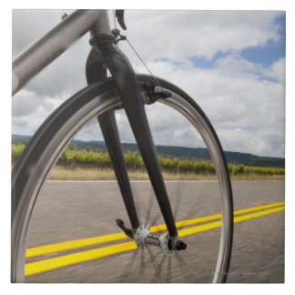 Man road biking at high speed POV Tile