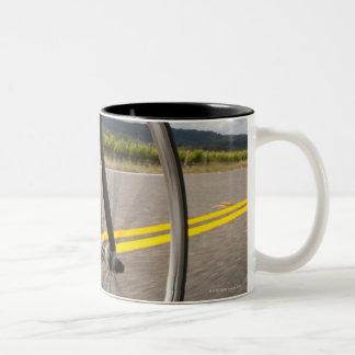 Man road biking at high speed POV Two-Tone Coffee Mug