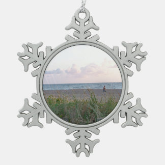 man running on beach painting style image pewter snowflake decoration