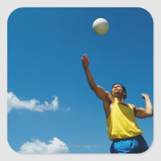 Man serving volleyball square sticker