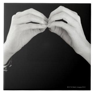 Man signing letter b in British sign language, Tile