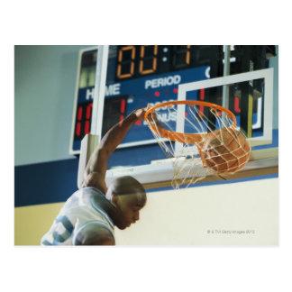 Man slam dunking basketball postcard