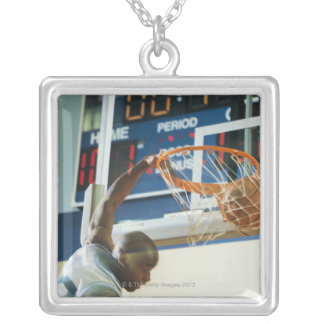 Man slam dunking basketball silver plated necklace