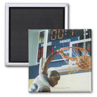 Man slam dunking basketball square magnet