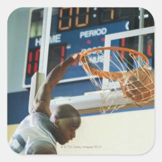 Man slam dunking basketball stickers