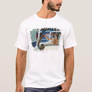 Man slam dunking basketball T-Shirt