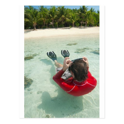 Man snorkeling in shallow water post cards