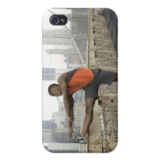 Man stretching on brooklyn bridge iPhone 4 case