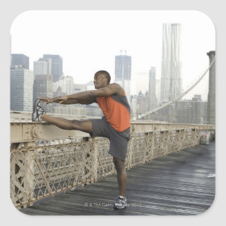Man stretching on brooklyn bridge square sticker