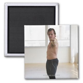 Man stretching on yoga mat square magnet
