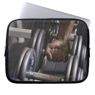 Man taking weight from rack laptop sleeve
