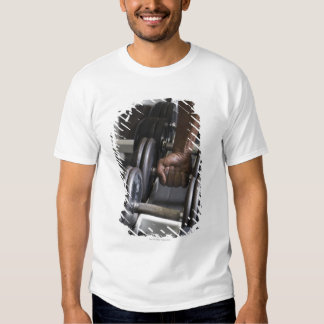 Man taking weight from rack tshirt