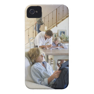 Man talking to little boy with brother using Case-Mate iPhone 4 cases