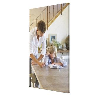 Man teaching his son at house canvas print