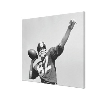 Man throwing football canvas print