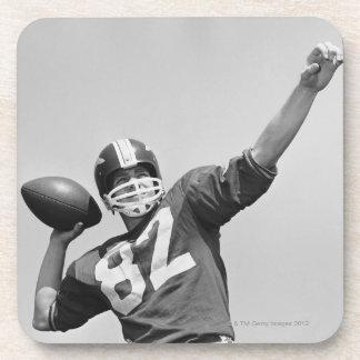 Man throwing football coaster