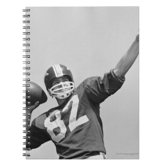 Man throwing football notebooks