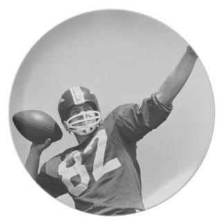 Man throwing football plate