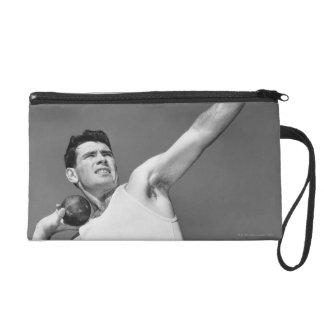 Man Throwing Shotput Wristlet