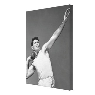Man Throwing Shotput Stretched Canvas Prints