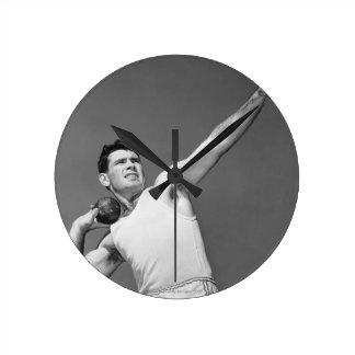 Man Throwing Shotput Round Wall Clock