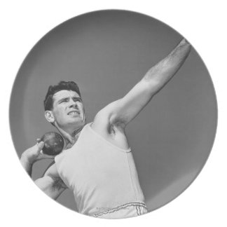 Man Throwing Shotput Plate