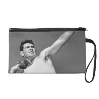 Man Throwing Shotput Wristlet Purse