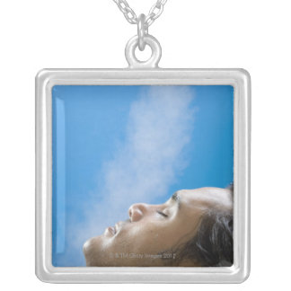 Man under steam faucet at spa silver plated necklace