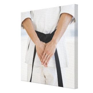 Man wearing karate black belt canvas print