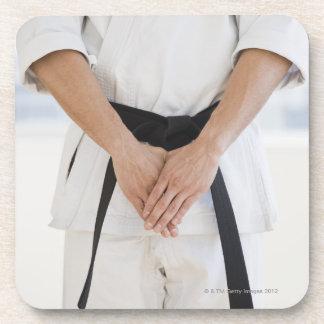 Man wearing karate black belt drink coaster
