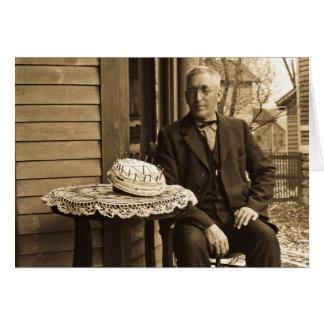Man with cake greeting card