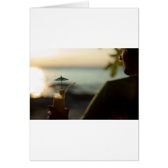 Man with cocktail at sunset card