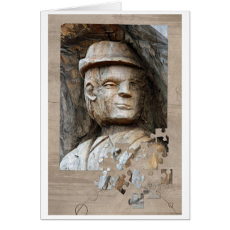 Man with hat carved in wood card
