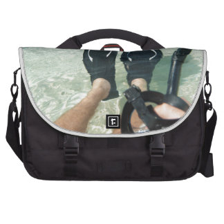 Man with snorkeling equipment commuter bags