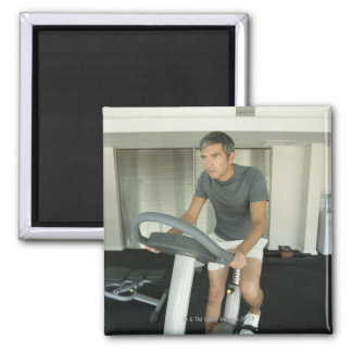 Man working out in a gym 2 square magnet