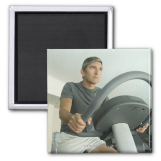 Man working out in a gym square magnet
