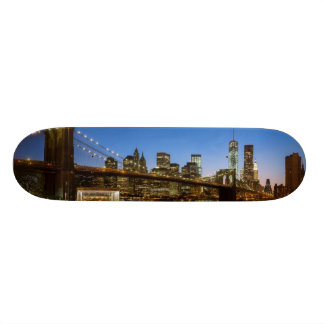 Manhattan and Brooklyn Bridge at dusk Skateboard