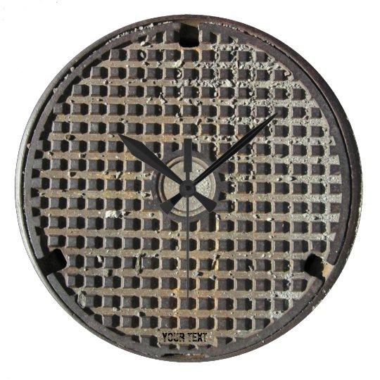 Manhole cover clock