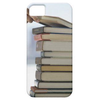 Man's hand taking a book from a stack of books barely there iPhone 5 case