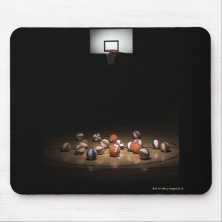 Many basketballs resting on the floor mouse pad