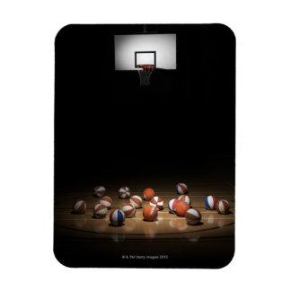 Many basketballs resting on the floor rectangular photo magnet