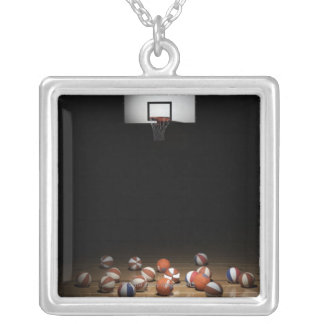 Many basketballs resting on the floor silver plated necklace