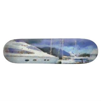 Many boats at a pier 21.6 cm skateboard deck
