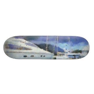 Many boats at a pier skateboard