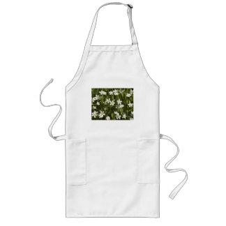 Many little white flowers in a green field long apron