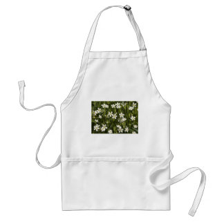 Many little white flowers in a green field standard apron