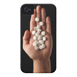 Many white pills in the palm of a person iPhone 4 covers